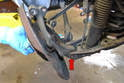 With everything free or removed wiggle the knuckle around until you can remove the lower control arm bolt (red arrow).