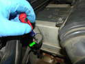 Locate the automatic transmission filler hole near the firewall on the passenger side of the engine.