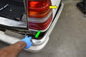 Pull the forward side sections away from the body first (yellow arrows) and then pull the bumper section back and off the car (green arrow).