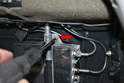 Use a flathead screwdriver and remove the clasp and antenna box attached to the mast (red arrow).