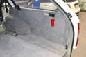 To access the rear washer reservoir open the access panel on the right rear of the interior.