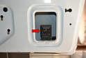 You can move the panel back far enough to access the relay (red arrow) which is located in an access hole in the frame of the hatch.