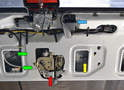 With the hatch panel off you can see the different components, the rear handle (blue arrow), the actuator (yellow arrow), the wiring connections (green arrows) and the lock (red arrow).