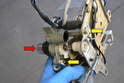 You can replace the lock tumbler (red arrow) separately by removing the two 8mm bolts (yellow arrows).