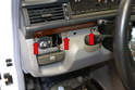 Use an 8mm socket and remove the three bolts holding the upper section of the lower dash in place (red arrows).