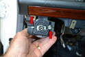 Turn the switch counter clockwise and remove it from the mount (red arrows).