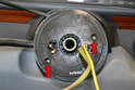 To remove the steering angle sensor use a Philips head screwdriver and remove the two small screws (red arrows).