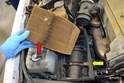 Pull the filter back and out of the air box (red arrow).