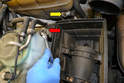 To remove the air box remove the 10mm nut and bracket by the windshield washer reservoir (red arrow).