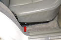 Rear Seat Bench: To remove the bench seat lift from the handle on the bottom of the seats (red arrow) and fold the seat forward.