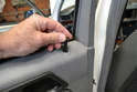 Begin by opening the rear door and unscrewing and removing the plastic lock pull.