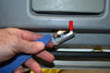 Use a trim removal tool and pop the light from the lower door panel edge.