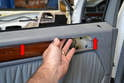 Pull or lift the door panel up and out from the window rail (red arrows).