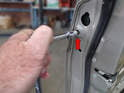 Begin by loosening the 3mm Hex screw that holds the locking cylinder in place.
