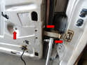 Use a 10mm socket and remove the three bolts holding the door to the stay (red arrows).