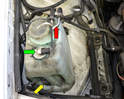 There are three components on the reservoir besides the reservoir itself: the level sensor (green arrow), the windshield fluid pump (yellow arrow, some reservoirs contain an additional pump for the headlight washers and the fluid heater (red arrow).