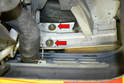 Remove one of the 13mm nuts from the front of the bumper to front cross member and loosen the other (red arrows).