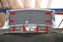 The grille is held in place by eight 8mm screws that attach to clips on the grille.