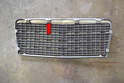 Check the back of the grille where the clips attach for cracks or damage (red arrow).