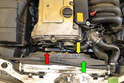 To remove the idler pulley (red arrow) you will need to remove the fan shroud.