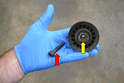 Things to check on the pulley are the bearing (yellow arrow) and the bolt.