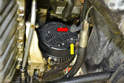 The voltage regulator is located on the rear of the alternator.