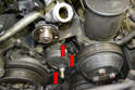 Use a 6mm Allen and remove the three bolts holding the tensioner to the engine (red arrows, one hidden).