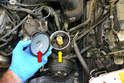 Undo the cap (red arrow, it just unscrews) from the reservoir (yellow arrow) and set aside.