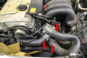 Remove all the coolant hoses from the pump and thermostat (red arrows).