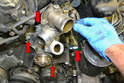There are four 6mm Allen bolts holding the coolant pump to the engine block (red arrows, only one shown).