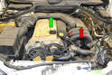 The resonance valve is located on the left side of the engine between the intake runners (red arrow).