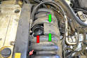 This photo illustrates the throttle body with the rubber bellows (red arrow) and the resonance valve.