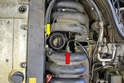 The throttle wiring harness wraps around the throttle body.