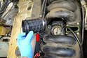With the lower hose clamp loosened you can remove the rubber bellows (red arrow).