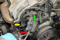 When installing the new valve make sure to reattach the ground wire (green arrow) on the upper mount and place the lower mount (red arrow) behind the EGR line bracket (yellow arrow).