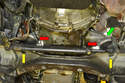 From under the vehicle you can see both mounts (red arrows) and the access holes (yellow arrows) for the lower mounting bolts.