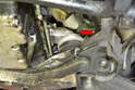 Left Side- Use a 17mm wrench and remove the upper mounting bolt (red arrow).