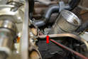 This photograph illustrates where the sender attaches to the oil filter housing base (red arrow).