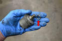Make sure to get the old crush washer off the sender and install a new washer to prevent oil leaks (red arrow).