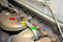 There are a few other systems that must be removed from the manifold before they can be removed from the engine; these include the EGR tube (red arrow), the air pump injection tube (yellow arrow) along with the manifold retaining nuts (green arrow).