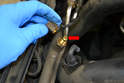 Open the cap on the Schrader valve (red arrow).
