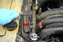 Use a10mm socket or wrench and remove the single bolt (red arrow) holding the wiring tray in place.