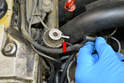 Disconnect the vacuum line from the fuel pressure regulator (red arrow).