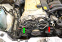 Remove the coolant hose along the front of the motor.