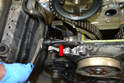 To loosen and remove the chain tensioner, first use a 10mm Allen and loosen the inner bolt one full turn (red arrow).