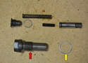 After cleaning and checking the condition of the tensioner you must reinstall everything in a particular order.