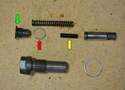Install the filler pin (yellow arrow) a new seal (red arrow) and the screw plug (green arrow) and torque to spec.