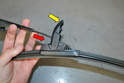 Our new blade had a lever that needed to be raised (yellow arrow) to allow the hooked end to pass through the blade.