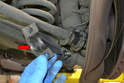 The sway bar bracket will be under a little tension from the weight of the suspension but is not under load and can be safely removed.