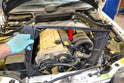 You should remove the fan shroud (red arrow) from the engine before you attempt to lift it.